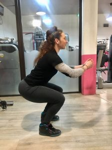 exercice squat fessiers